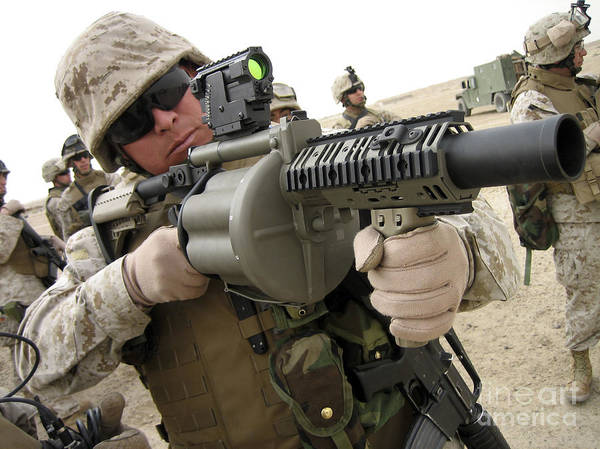 Grenade Launcher Wall Art - Photograph - A Marine Aims In With The M-32 Multiple by Stocktrek Images
