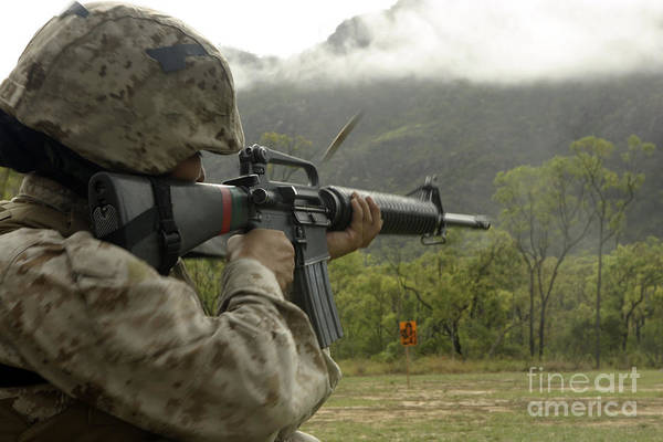 Mounted Shooting Photograph - A Marine Conducts Drills With An M16-a2 by Stocktrek Images