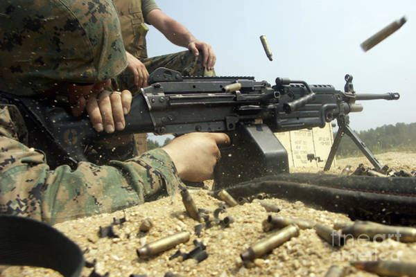 Gunfire Photograph - A Marine Engages Targets With An M-249 by Stocktrek Images