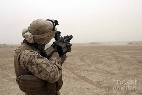 Grenade Launcher Wall Art - Photograph - A Marine Fires The M-32 Multiple Shot by Stocktrek Images