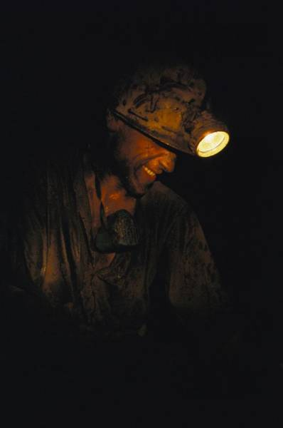 Czechoslovakia Photograph - A Miner With A Head Lamp Works by James P Blair