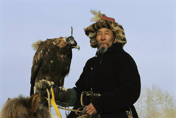 Ethnic Minority Photograph - A Mongolian Eagle Hunter In Kazakhstan by Ed George