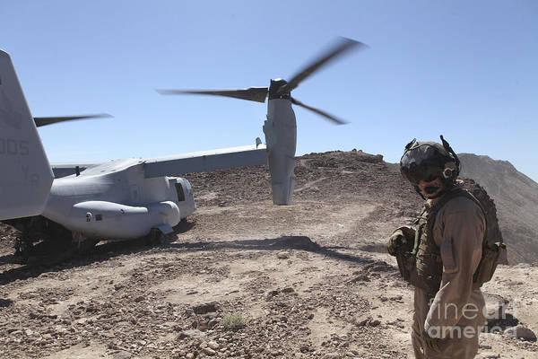 Mv-22 Photograph - A Mv-22 Osprey Tiltrotor Lands by Stocktrek Images