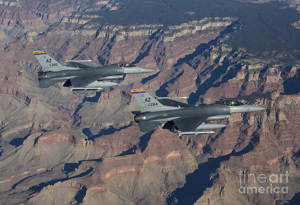 F-16 Photograph - A Pair Of F-16s Fly In Formation by HIGH-G Productions
