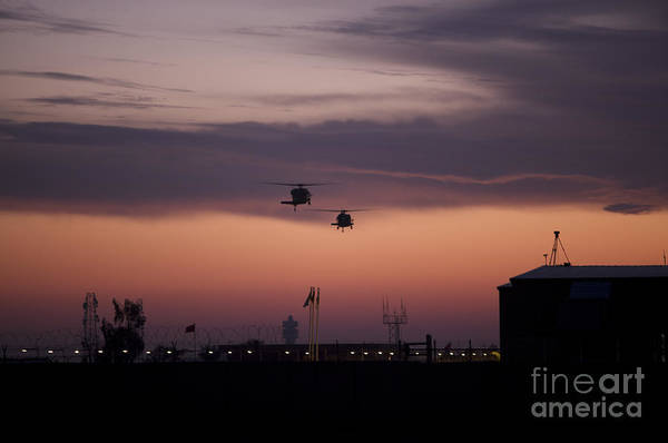 Utility Helicopter Photograph - A Pair Of Uh-60 Black Hawk Helicopters by Terry Moore