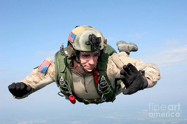 Skydiver Photograph - A Pararescueman Checks His Altitude by Stocktrek Images