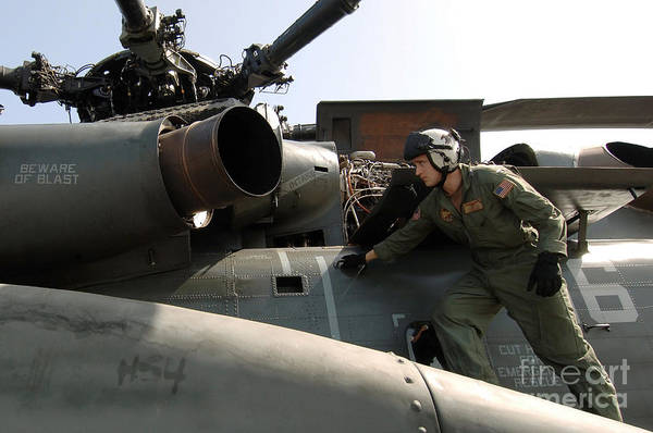 Bahrain Photograph - A Pilot Performs A Preflight Inspection by Stocktrek Images