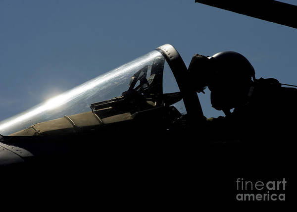 Elmendorf Photograph - A Pilot Prepares For Take-off by Stocktrek Images