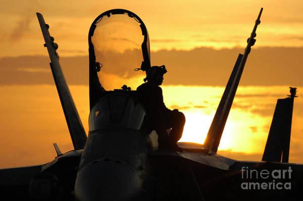 Photograph - A Plane Captain Enjoys A Sunset by Stocktrek Images