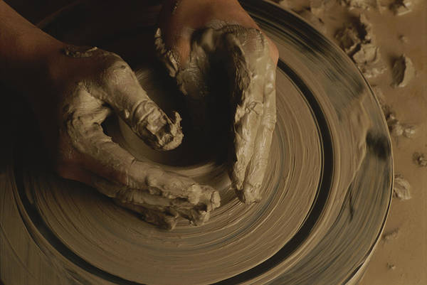 Potters Wheel Wall Art - Photograph - A Potter Makes A Pot From Clay by Stephen Alvarez