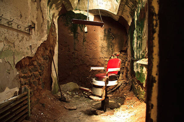 Wall Art - Photograph - A Red Barber Chair In A Spotlight  by Ellie Teramoto