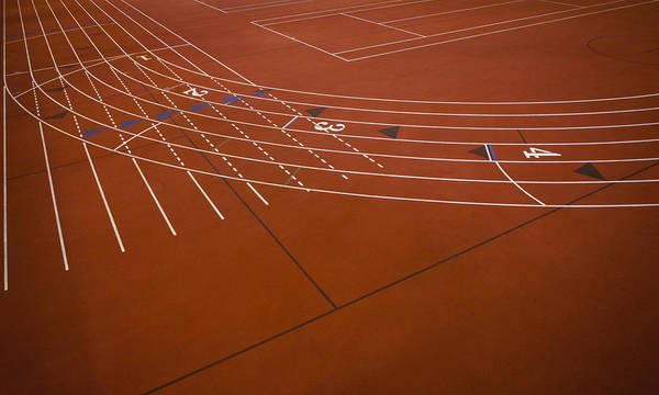 Wall Art - Photograph - A Red Running Track Athletics Ground by Christian Scully