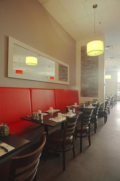 Wall Art - Photograph - A Restaurant Interior Red Banquette by Charles Knox