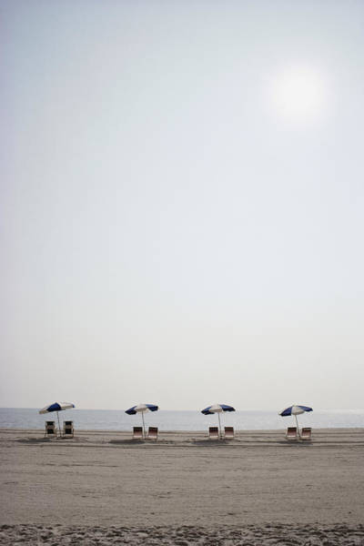Rehoboth Beach Photograph - A Row Of Empty Chairs by Stephen St. John