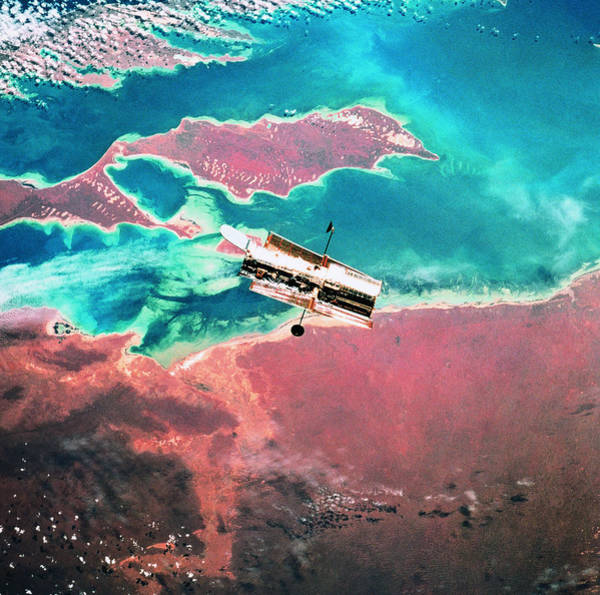High Speed Photograph - A Satellite Orbiting Above The Earth by Stockbyte