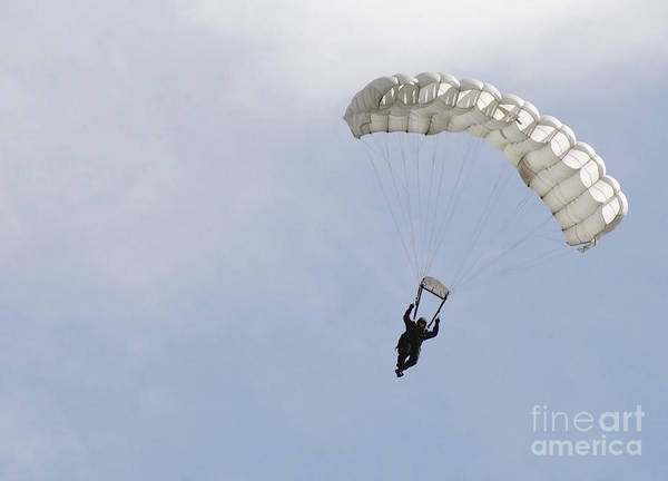 Skydiver Photograph - A Soldier Floats To The Ground by Stocktrek Images