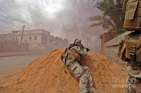 Gunfire Photograph - A Soldier Lays Down A Vicious Barrage by Stocktrek Images