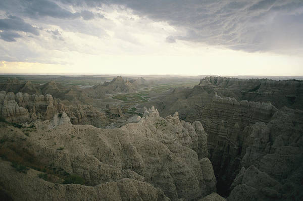North Dakota Badlands Wall Art - Photograph - A Storm Moves Over Sheep Mountain Table by Annie Griffiths