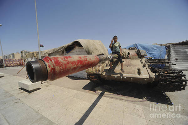 Photograph - A T-55 Tank With Two Children Playing by Andrew Chittock