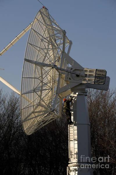 Sagamore Wall Art - Photograph - A Technician Climbs Up A Large Radio by Stocktrek Images