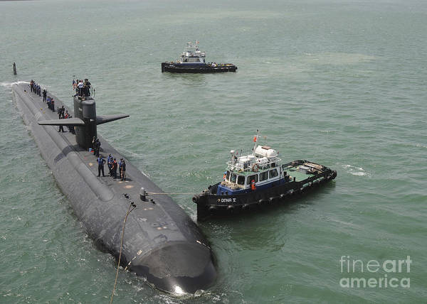 Bahrain Photograph - A Tugboat Guides Attack Submarine Uss by Stocktrek Images