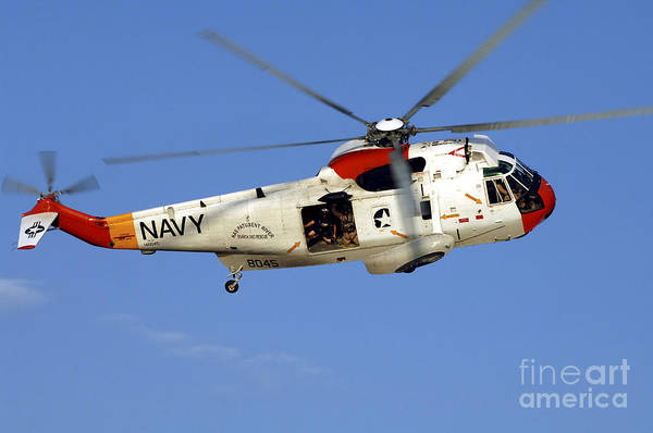 Utility Aircraft Photograph - A Uh-3h Sea King Helicopter Flies by Stocktrek Images