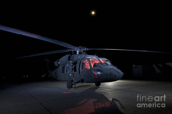 Utility Helicopter Photograph - A Uh-60 Black Hawk Helicopter Parked by Terry Moore