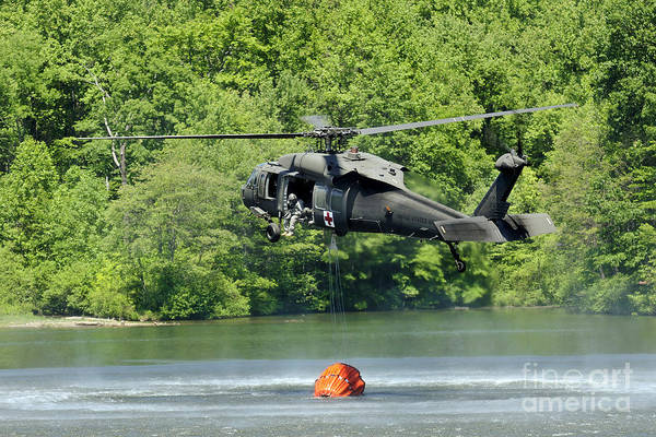 Utility Helicopter Photograph - A Uh-60 Blackhawk Helicopter Fills by Stocktrek Images
