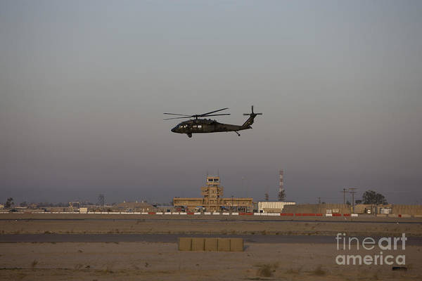 Utility Aircraft Photograph - A Uh-60 Blackhawk Helicopter Flies by Terry Moore