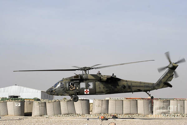 Photograph - A Uh-60 Blackhawk Prepares To Land by Terry Moore