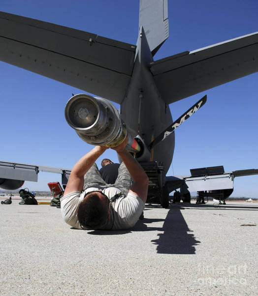 Photograph - A U.s. Air Force Airman Lifts The Boom by Stocktrek Images