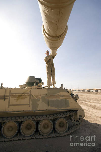 Photograph - A Us Army Mechanic Uses A M113 by Terry Moore