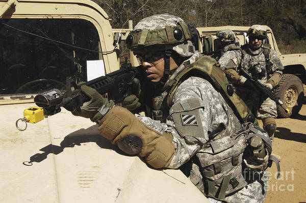 Photograph - A U.s. Army Soldier Pulls Security by Stocktrek Images