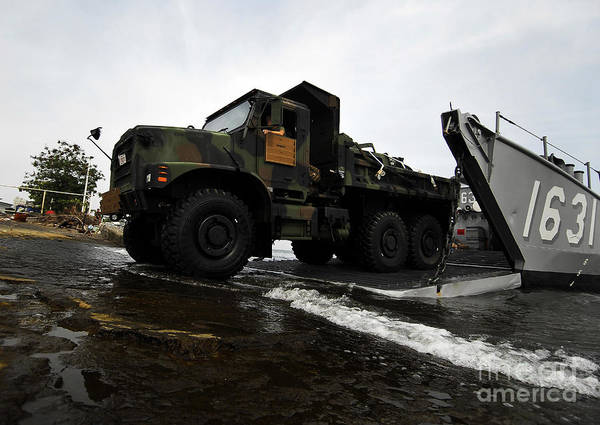 Amphibious Assault Ship Wall Art - Photograph - A U.s. Marine Corps 7-ton Truck Rolling by Stocktrek Images