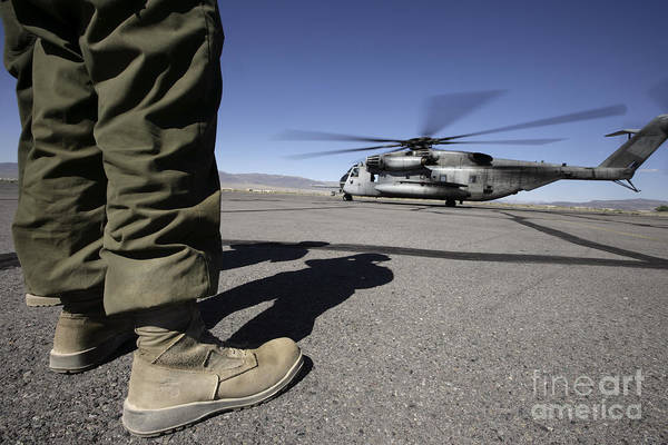 Airbase Photograph - A U.s. Marine Corps Airframe Mechanic by Stocktrek Images