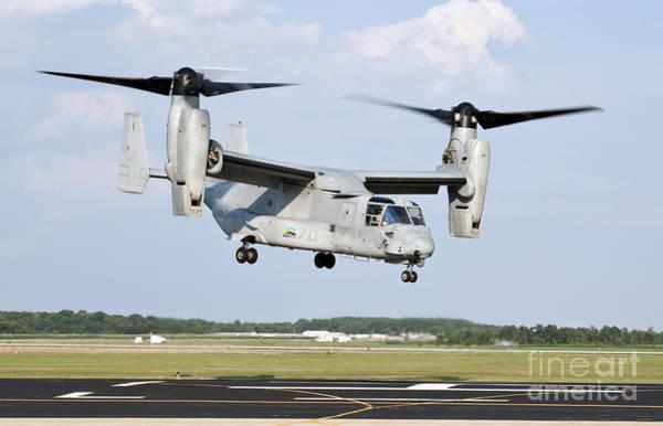Mv-22 Photograph - A U.s. Marine Corps Mv-22 Osprey Lifts by Stocktrek Images