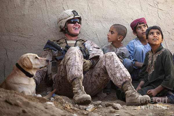 Photograph - A U.s. Marine Jokes With Afghan by Stocktrek Images