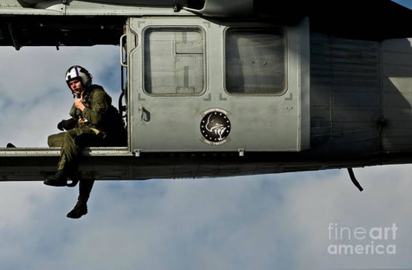 Uss Carl Vinson Photograph - A U.s. Navy Naval Air Crewman Guides by Stocktrek Images
