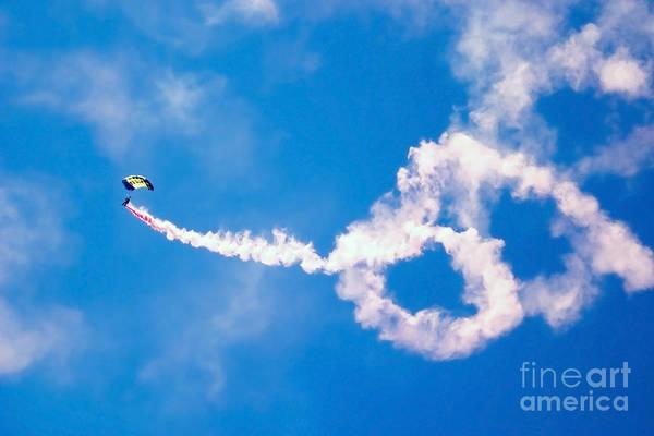 Photograph - A U.s. Navy Parachute Team Leap Frogs by Stocktrek Images