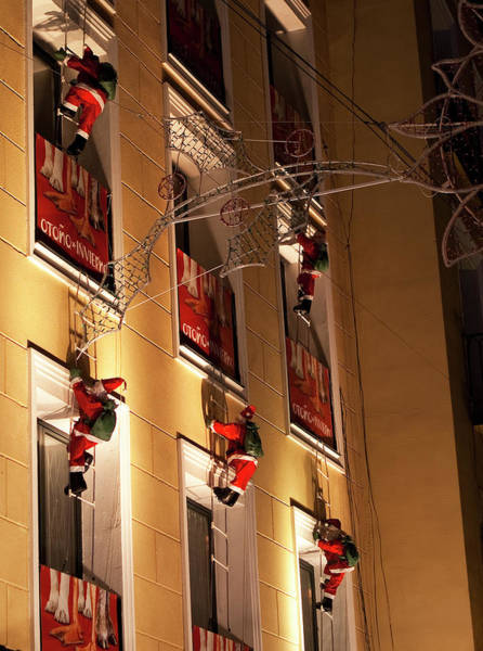 Photograph - A Wall Of Sneaky Santas by Lorraine Devon Wilke