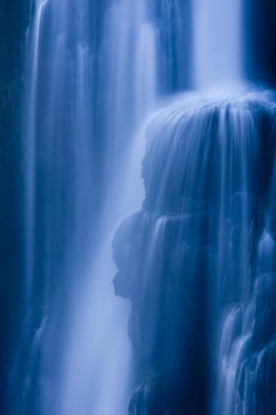 A Waterfall Splashes Off Of A Large Art Print