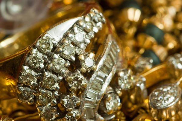 Jewelery Photograph - A White Gold Bracelet Among Other Yellow Gold Jewellery by Ashish Agarwal
