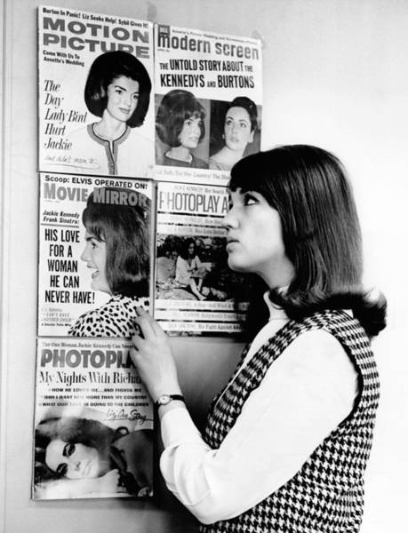 Tabloids Photograph - A Young Women Observes A Display by Everett