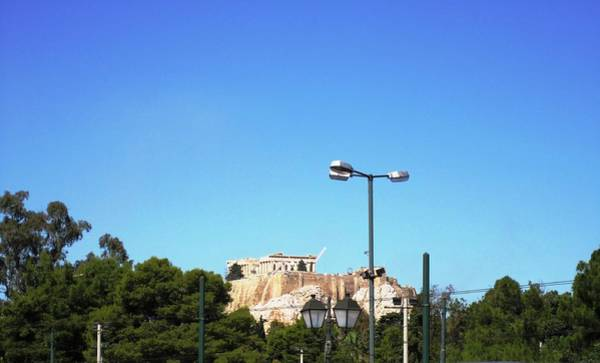 Photograph - Acropolis Sits On The Hilltop In The Far Distance From The Street Lamp Post In Athens Greece by John Shiron