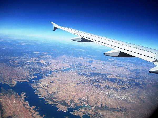 Photograph - Aerial View With Airplane Wing On Take Off From Madrid Airport In Spain  by John Shiron
