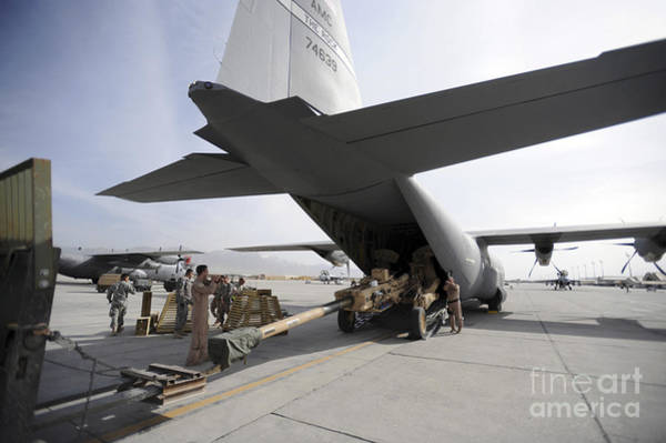 Photograph - Aircrew Load An M777 A2 Howitzer Onto by Stocktrek Images