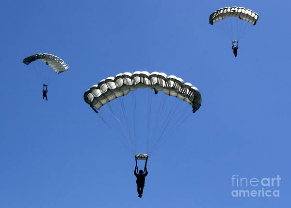 Skydiver Photograph - Airmen Perform A High Altitude Low by Stocktrek Images