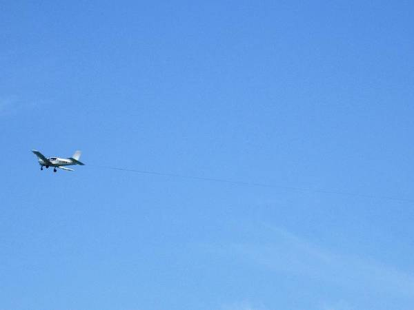 Photograph - Airplane Flying Over Costa Del Sol Beach Spain by John Shiron
