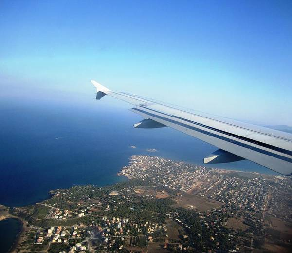 Photograph - Airplane Wing Aerial View Mediterranean Sea Landing In Athens South Of Greece by John Shiron
