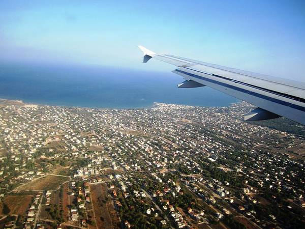 Photograph - Airplane Wing Span Aerial View Mediterranean Sea Landing In Athens South Of Greece. by John Shiron